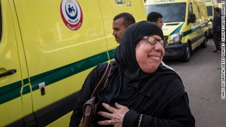 CAIRO, EGYPT - DECEMBER 12:  A woman cries as she walks with an ambulance carrying the bodies of the victims of yesterdays St Peter and St Paul Church explosion after the official funerals on December 12, 2016 in Cairo, Egypt. The blast inside the church killed 25 people mainly women and children.  (Photo by Chris McGrath/Getty Images)