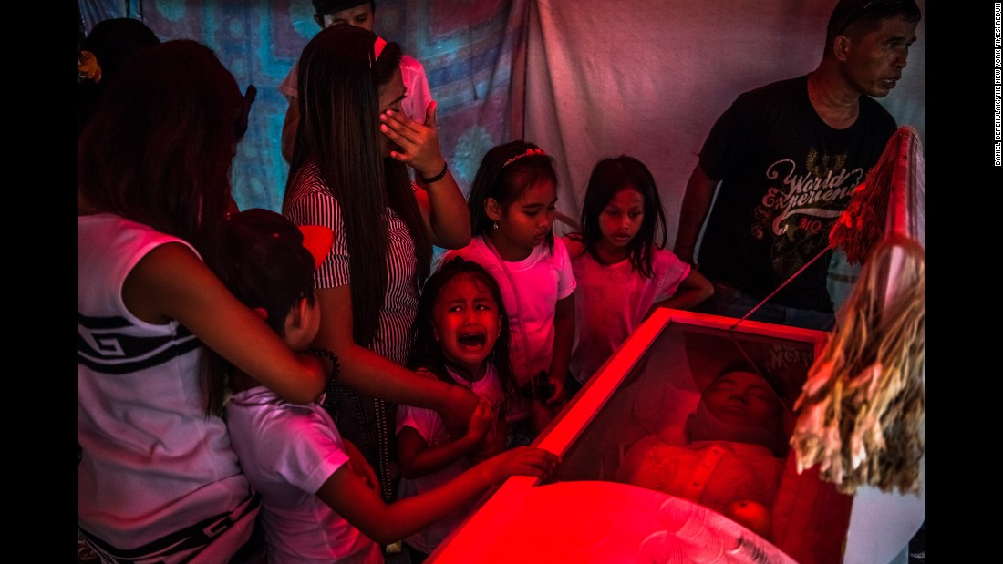 "<strong>October 9: </strong>Jimji, 6, cries out ""Papa"" as workers move the body of her father, Jimboy Bolasa, for burial in Manila, Philippines. Bolasa, 25, was found dead along with his neighbor. New Philippines President Rodrigo Duterte campaigned hard on <a href=""http://www.cnn.com/2016/08/03/asia/philippines-war-on-drugs/"" target=""_blank"">a no-nonsense approach to crime,</a> and on several occasions he has hinted openly that he doesn't oppose his police force or even citizens taking the lives of suspected criminals. Critics see the approach as a complete disregard of due process. ""It's absolutely crippling to see that image and to see that little girl experiencing so much pain and loss; to know that her father was never given a trial, never had the opportunity to defend himself in front of a court,"" <a href=""http://time.com/top-10-photos-2016/"" target=""_blank"">Daniel Berehulak said</a> about the photo, which he took<a href=""http://www.nytimes.com/interactive/2016/12/07/world/asia/rodrigo-duterte-philippines-drugs-killings.html"" target=""_blank""> on assignment for The New York Times.</a> ""He was tortured and executed in the space of 30-45 minutes."" <a href=""http://www.cnn.com/2016/08/28/asia/philippines-voices-drugs-war/index.html"" target=""_blank"">Duterte's crackdown: 6 stories from the front lines</a>"
