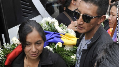 The mother (R) of Yuliana - a seven-year-old girl who was raped, tortured and murdered - is comforted after a mass held in the victim's honour at the Santa Teresita church in Bogota, Colombia, on December 7, 2016.  A seven-year-old girl was raped, tortured and murdered in Bogota this weekend, allegedly by a 38-year-old man who kidnapped the girl from her low-income neighborhood on the east side of the city and took her to a luxury apartment belonging to his family, the police said. The girl's body was found on the scene, showing signs of torture and sexual abuse. / AFP / GUILLERMO LEGARIA        (Photo credit should read GUILLERMO LEGARIA/AFP/Getty Images)