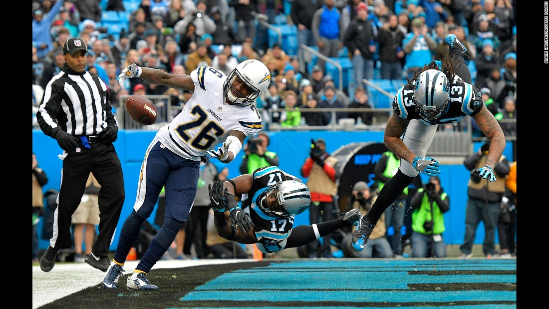 San Diego defensive back Casey Hayward, left, tries to pull in a tipped pass during an NFL football game in Charlotte, North Carolina, on Sunday, December 11.