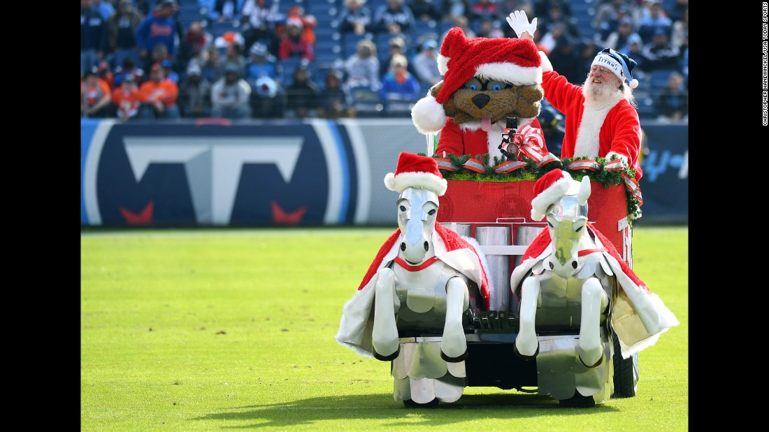T-Rac, the mascot of the NFL's Tennessee Titans, rides in a sleigh with Santa Claus before a home game against Denver on Sunday, December 11.