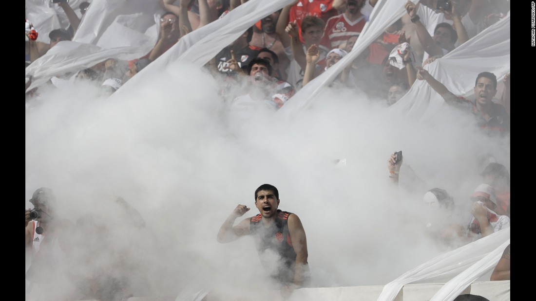 Fans of the Buenos Aires soccer club River Plate cheer for their team before a match with city rivals Boca Juniors on Sunday, December 11. Boca won the match 4-2.