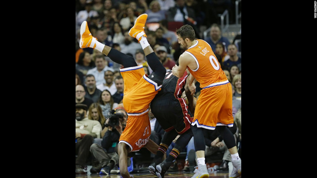 Cleveland's Tristan Thompson flips over Miami's Hassan Whiteside during an NBA basketball game in Cleveland on Friday, December 9.