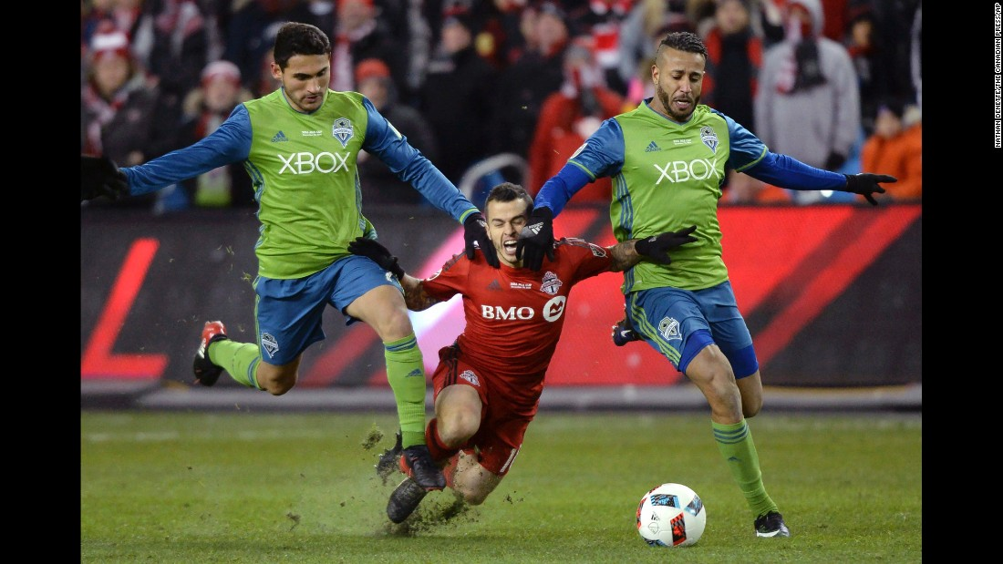Toronto forward Sebastian Giovinco is sandwiched between Seattle's Cristian Roldan, left, and Tyrone Mears during the MLS Cup final on Saturday, December 10. After the match finished scoreless, Seattle won the title in a penalty shootout.