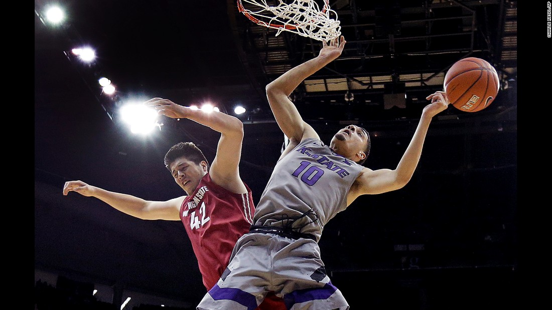 Kansas State's Isaiah Maurice, right, blocks a shot by Washington State's Conor Clifford during a college basketball game in Kansas City, Missouri, on Saturday, December 10.