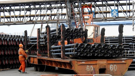 A Chinese worker loads steel tubes onto a truck at a logistics center in Lianyungang in east China's Jiangsu province on November 8, 2016.  Chinese exports sank for a seventh consecutive month in October, data showed on November 8, as weak global demand dealt a blow to the world's number two economy following recent signs of stability. / AFP / STR / China OUT        (Photo credit should read STR/AFP/Getty Images)