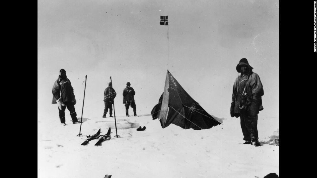 "Scott's team, seen here around the Norwegian flag, did not survive its return trip. Edgar Evans died in a fall on February 17, 1912. Scott, E.A. Wilson, H.R. Bowers and L.E.G. Oates perished the next month after getting caught in a blizzard. ""Every day we have been ready to start for our depot 11 miles away, but outside the door of the tent it remains a scene of whirling drift,"" Scott wrote in his final diary entry on March 29, 1912. ""We shall stick it out to the end, but we are getting weaker, of course, and the end cannot be far. It seems a pity, but I do not think I can write more."" Their bodies were found in November 1912, and Scott's wife was awarded a knighthood that would have been his had he survived."