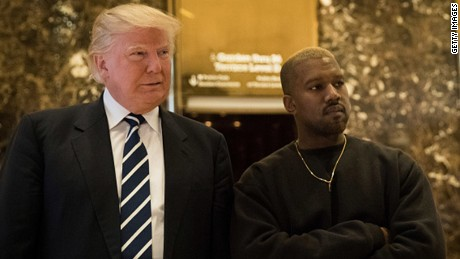 NEW YORK, NY - DECEMBER 13: (L to R) President-elect Donald Trump and Kanye West stand together in the lobby at Trump Tower, December 13, 2016 in New York City. President-elect Donald Trump and his transition team are in the process of filling cabinet and other high level positions for the new administration.