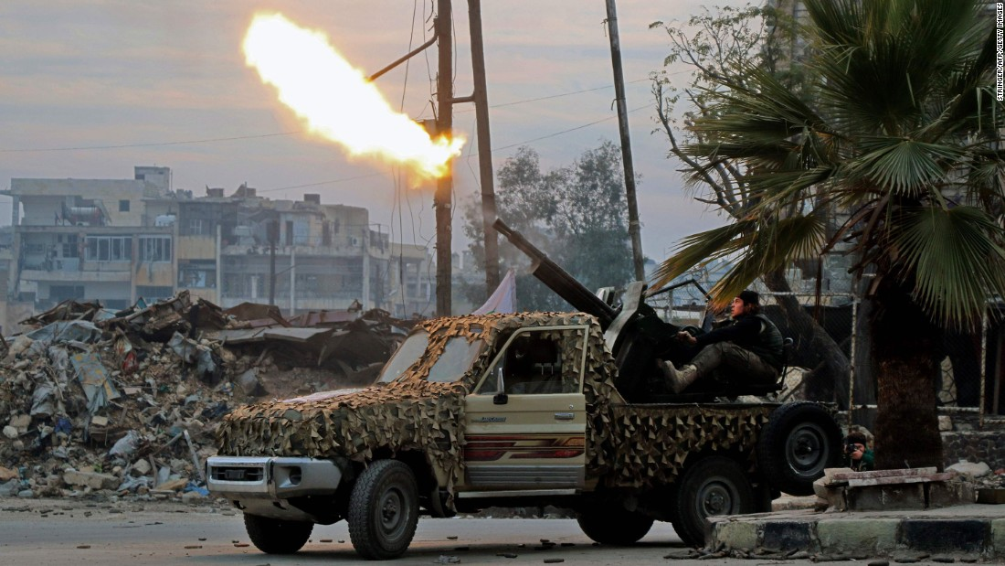 Rebels in southeastern Aleppo target government forces with anti-aircraft weaponry on December 12.