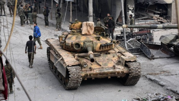 Pro-government forces patrol the al-Saleheen neighborhood in eastern Aleppo on December 12.
