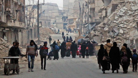 Civilians flee the Sukkari neighborhood in southeastern Aleppo on December 12.