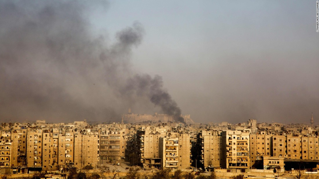 Smoke rises from the Bustan al-Qasr neighborhood on December 12.