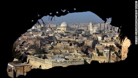 TOPSHOT - A general view shows damaged buildings in old Aleppo's Jdeideh neighbourhood on December 9, 2016. Syria's government has retaken at least 85 percent of east Aleppo, which fell to rebels in 2012, since beginning its operation on November 15. / AFP PHOTO / George OURFALIANGEORGE OURFALIAN/AFP/Getty Images
