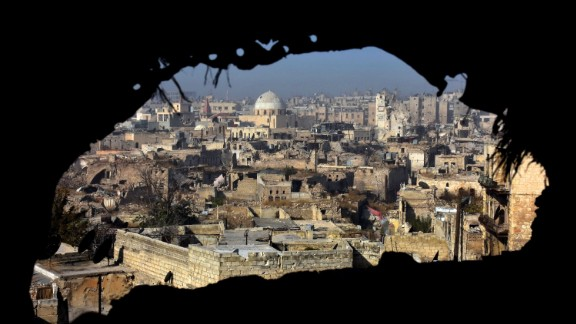 TOPSHOT - A general view shows damaged buildings in old Aleppo