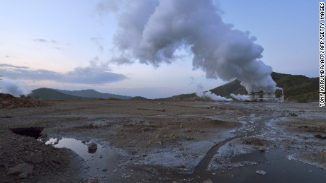 A plume of steam billows from a three-kilometres deep open well, at the ol-Karia geothermal power generation complex that lies on the floor of the Kenyan Rift Valley, near the shores of Lake Naivasha, some 120 kilometers north-east of capital Nairobi, on August 28, 2015. Kenyas installed steam power capacity now stands at 579MW, ahead of giant economies such as Japan, Russia, China and Germany  according to a study presented to the World Bank by state-owned KenGen, with ambitions to scale up to 5,000 megawatts by 2030 Olkaria is one of the largest single geothermal investment projects in the world and geothermal the largest source of electricity for Kenya today, accounting for a mere 13% of the national grid in 2010, after hydro-energy. AFP PHOTO/TONY KARUMBA        (Photo credit should read TONY KARUMBA/AFP/Getty Images)