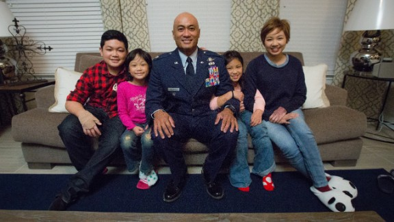 Kato sits with his children: from left, 13-year-old Kimo, 7-year-old Kialani, 9-year-old Noelani and Kianni. He says he doesn