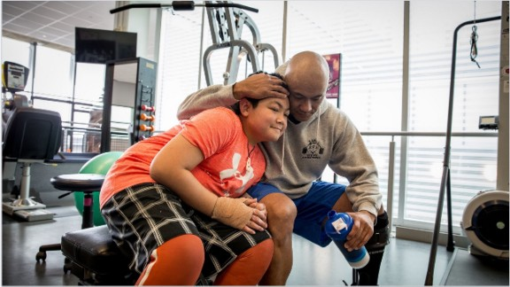 Martinez hugs his son, Kimo, at the Center for the Intrepid, a military rehabilitation facility in San Antonio. Kimo sustained third-degree burns in the Brussels airport attack. The 13-year-old wants to study at the MIT and design high-performance cars.