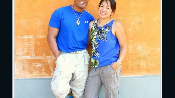 Martinez and his wife Gail pose for a photo on a family trip to Pisa, Italy. Gail