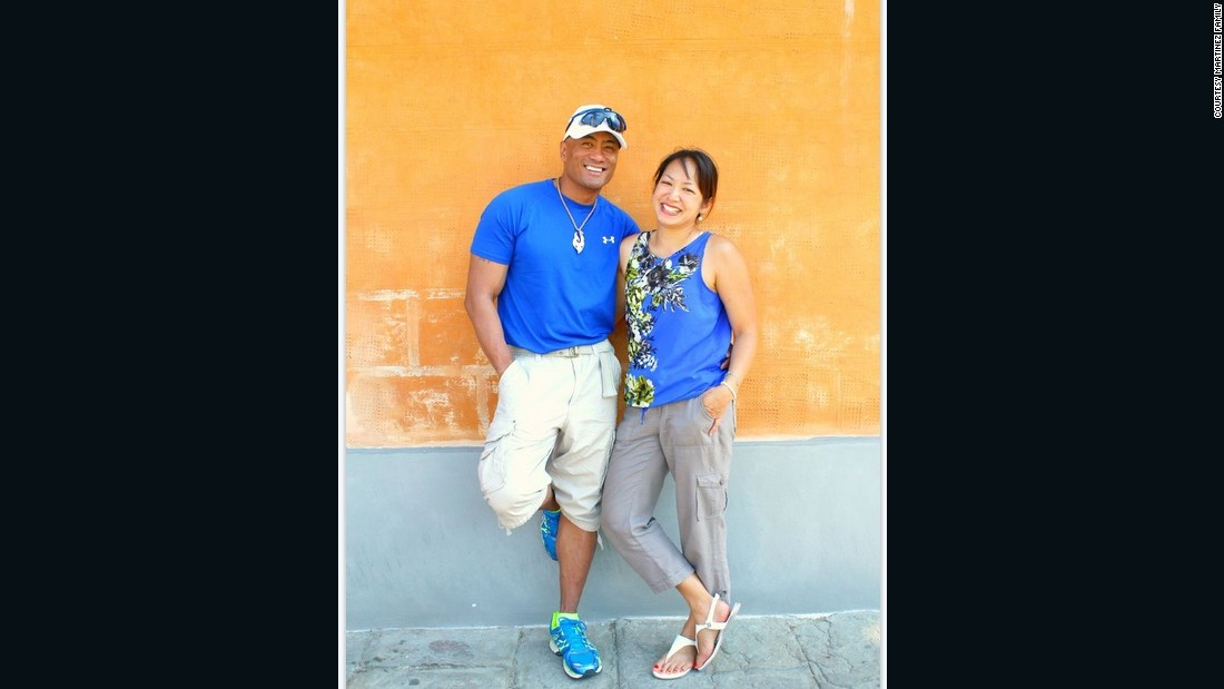 Martinez and his wife Gail pose for a photo on a family trip to Pisa, Italy. Gail's children say she had an eye for photography and was drawn to this orange wall, where the family took a series of portraits.