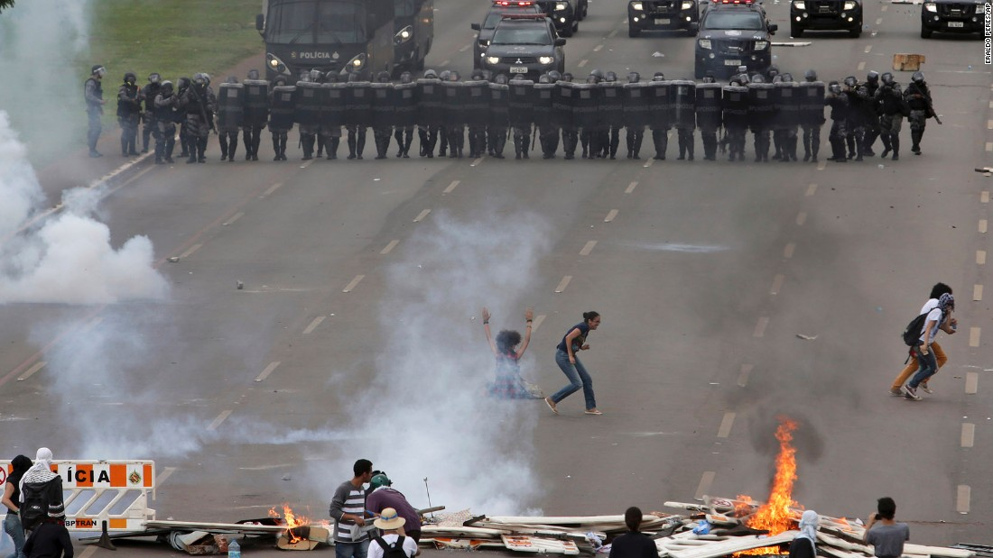 Demonstrators face-off with police in the city of Brasilia on Tuesday, December 13.