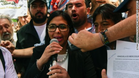 Venezuela's Foreign Minister Delcy Rodriguez, speaks to supporters outside the Argentine Foreign Ministry in Buenos Aires as Mercosur's ministers attend a meeting where Venezuela was not invited, on December 14, 2016. Mercosur's foreign ministers debate on Venezuela's suspension from the group after accusations that the leftist government in Caracas failed to meet democratic and trade standards. / AFP / EITAN ABRAMOVICH        (Photo credit should read EITAN ABRAMOVICH/AFP/Getty Images)
