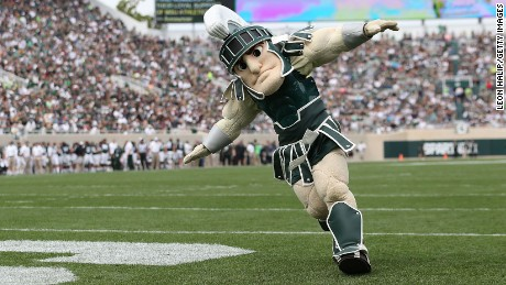 "EAST LANSING, MI - SEPTEMBER 20:  Michigan State Spartans mascott ""SPARTY"" entertains the fans during the third quarter of the game against Eastern Michigan Eagles at Spartan Stadium on September 20, 2014 in East Lansing, Michigan. Michigan State defeated Eastern Michigan 73-14.  (Photo by Leon Halip/Getty Images)"