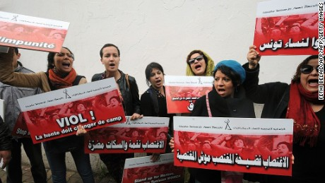 Tunisian activists shout slogans during a 2014 protest opposing violence against women.