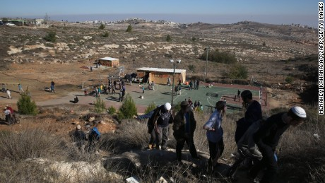 Young Israeli settlers gather in the settlement outpost of Amona, which was established in 1997, in the Israeli-occupied West Bank on December 9, 2016. Hundreds of supporters of Israel's settler movement arrived at the outpost, where some 40 families live, to protest against the Israeli high court order to demolish the place by December 25 because it was built on private Palestinian land. / AFP / - / MENAHEM KAHANA        (Photo credit should read MENAHEM KAHANA/AFP/Getty Images)