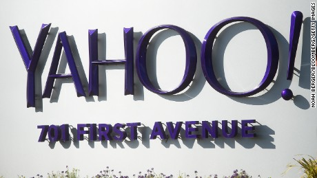 People walk on the Yahoo! Inc. headquarters corporate campus in Sunnyvale, California, U.S., on Thursday, Jan. 7, 2016. Yahoo! Inc. is planning to eliminate jobs as part of Chief Executive Officer Marissa Mayer's effort to cut costs and revive growth at the struggling web portal, according to a person familiar with the matter. Photographer: Noah Berger/Bloomberg via Getty Images