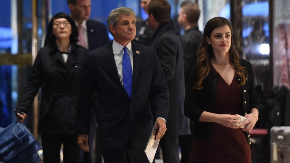 US Rep. Michael McCaul (R-TX), flanked by a presidential transition team aide Madeleine Westerhout, arrives at Trump Tower during another day of  meetings with President-elect Donald Trump November 29, 2016 in New York.