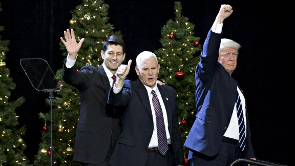 "Trump, Pence and House Speaker Paul Ryan wave during an event in West Allis, Wisconsin, on Tuesday, December 13. ""He's like a fine wine,"" Trump said of Ryan at the rally, which was part of his ""thank you"" tour to states that helped him win the election. ""Every day that goes by, I get to appreciate his genius more and more."""
