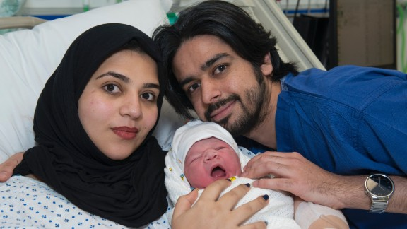 Moaza Al Matrooshi and her husband, Ahmed, with their new son, Rashid.