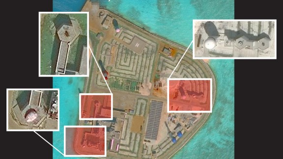 A satellite image of Johnson Reef taken on November 29. AMTI says the military structures on this island are less complex than the newer ones on Fiery Cross, Mischief, and Subi Reefs.