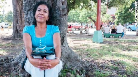 Osiris Aleman, 55, was unable to connect online with her daughter in Mexico via a public Wi-Fi spot in Havana.