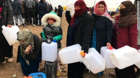 Shelter, food and water are provided, but refugees must wait in line to collect supplies.