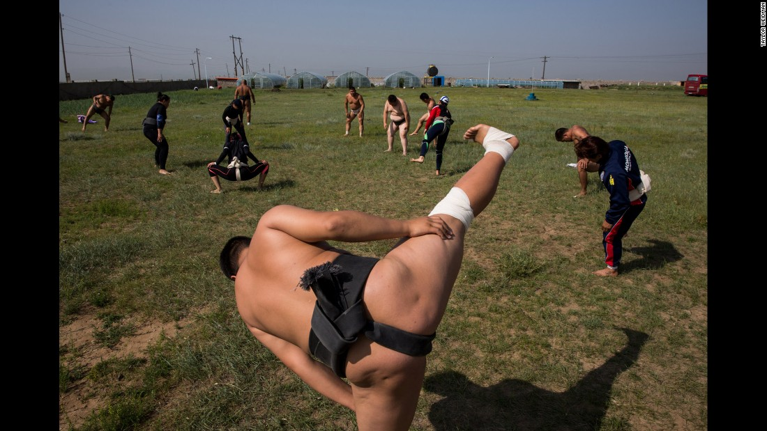 Sumo wrestlers stretch during a training camp on the outskirts of Ulaanbaatar, Mongolia, in July. Photographer Taylor Weidman shadowed young wrestlers before the World Sumo Championships, where they hoped to make a name for themselves and find a future with a sumo stable.