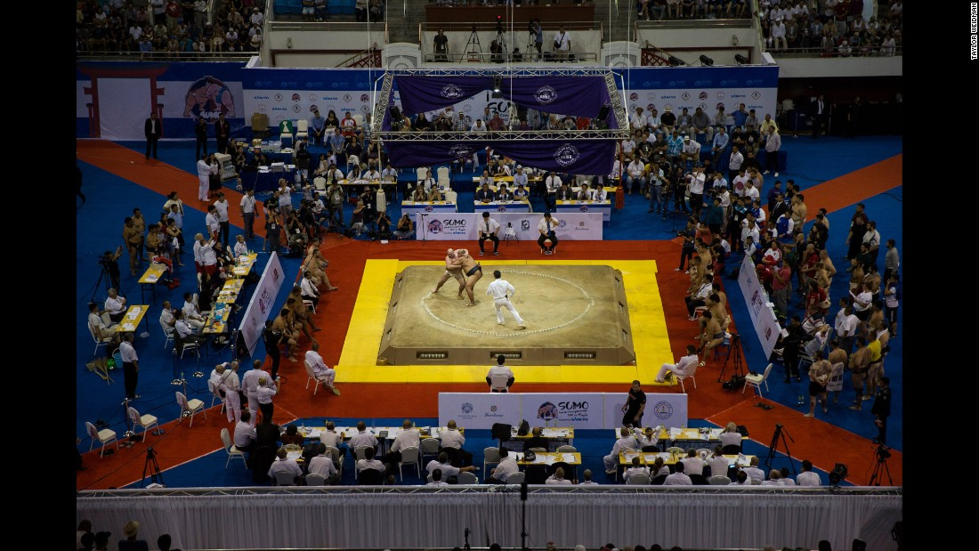 Wrestlers compete during the World Sumo Championships.