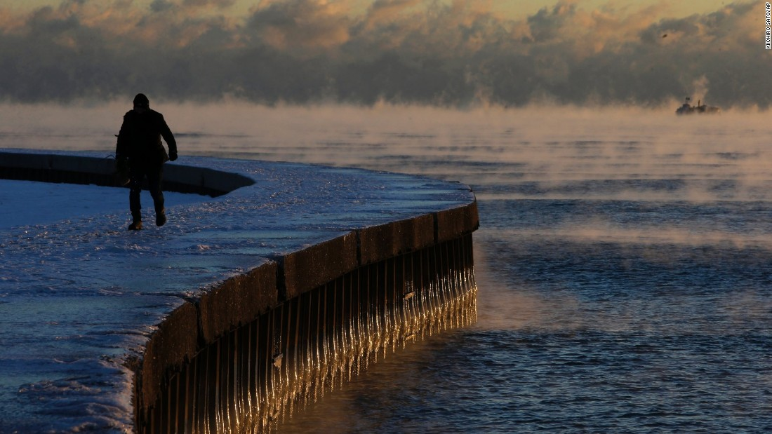Steam rises on the surface of Lake Michigan at sunrise on December 15 in Chicago.