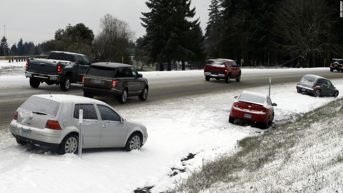 Commuters pass abandoned cars on I-205 in Wilsonville, Oregon, on December 15.