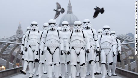 "LONDON, ENGLAND - DECEMBER 15:  People dressed as Stormtroopers from the Star Wars franchise of films pose on the Millennium Bridge to promote the latest release in the series, ""Rogue One"", on December 15, 2016 in London, England.  ""Rogue One: A Star Wars Story"" is the first of three standalone spin-off films and is due for released in the UK today.  (Photo by Leon Neal/Getty Images)"