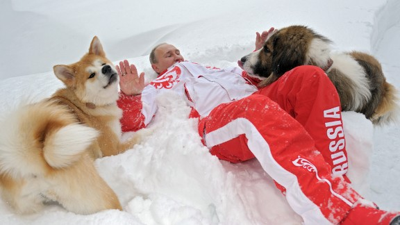 Putin plays with his dogs Yume, left, and Buffy at his home in Novo-Ogaryovo, Russia, in March 2013.