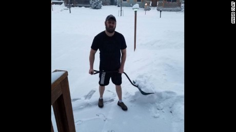 It's not too cold in Montana to keep Steve Clay from shoveling in just shorts and a T-shirt.