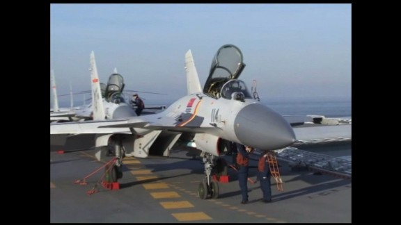 Beijing's latest show of force comes as tensions escalate over the South China Sea.