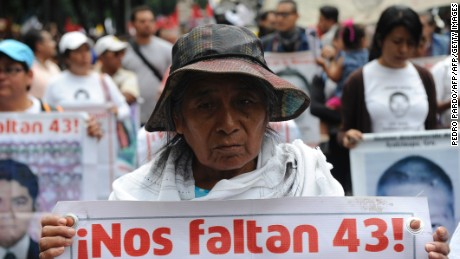 Parents, other relatives and people in general take part in a protest in Mexico City, on September 26, 2016, to commemorate the second anniversary of the Ayotzinapa teachers school's students disappearance.  The students, from a rural teachers college in the southern state of Guerrero, disappeared after they were attacked by local police in the city of Iguala on September 26, 2014. / AFP / Pedro Pardo        (Photo credit should read PEDRO PARDO/AFP/Getty Images)
