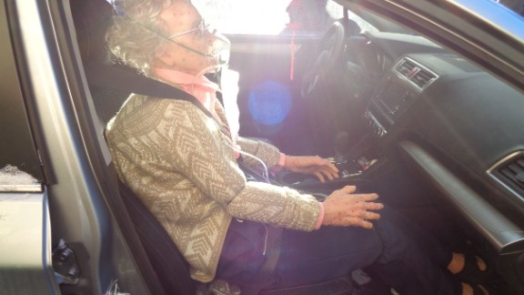 Police photo shows life sized mannequin in detail, seated in front passenger seat and wearing a seat belt