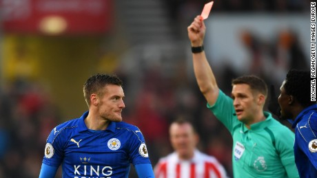 Jamie Vardy of Leicester City is shown a red card by referee Craig Pawson during its match at Stoke City.