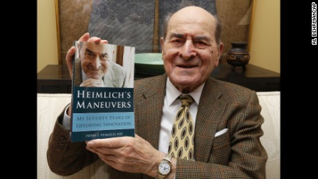 Dr. Henry Heimlich holds his memoir prior to being interviewed at his home in Cincinnati.