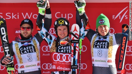 Marcel Hirscher is flanked by France's Mathieu Faivre (left) and Italy's Florian Eisath on the podium at Alta Badia.