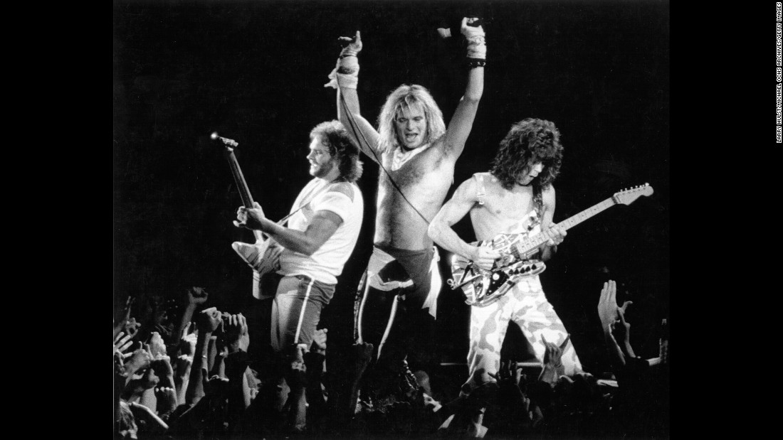 "This band's core members -- brothers Eddie, on guitar (right) and Alex Van Halen on drums -- were born in the Netherlands before their family moved to Southern California. By 1978 they had joined bassist Michael Anthony (left) and singer David Lee Roth  (center) and released their debut album. Immediately Guitar Magazine called Eddie Van Halen ""the most influential American guitarist since Jimi Hendrix."" After several hugely successful albums, Roth and the band famously parted ways in 1985, replaced by Sammy Hagar, who helped Van Halen's continued success. Recently the band started touring with Roth and Eddie Van Halen's son Wolfgang on bass. Overall, Van Halen has sold 56 million units nationwide, according to the Recording Industry Association of America."