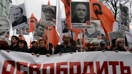 "Thousands of Russians carry placards of political prisoners including Khodorkovsky and a banner reading ""Freedom!"" during an opposition rally in Moscow in 2013."